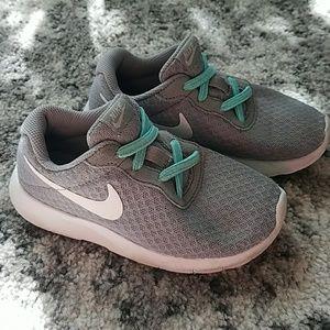 Gray Nike tennis shoes, 11c girls